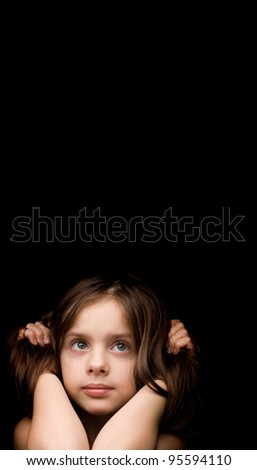 beautiful little girl on a black background - stock photo