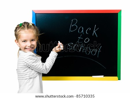 beautiful little girl on a board. stodio shot - stock photo