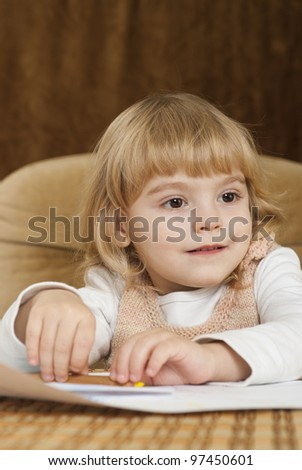 Beautiful little girl on a brown background