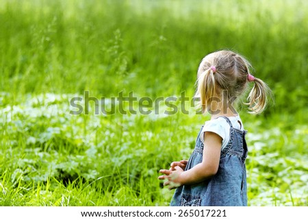 beautiful little girl on nature - stock photo
