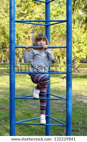 beautiful little girl on playground - stock photo