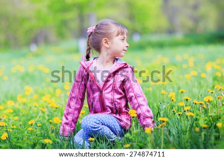 Beautiful little girl outdoors in sunny day