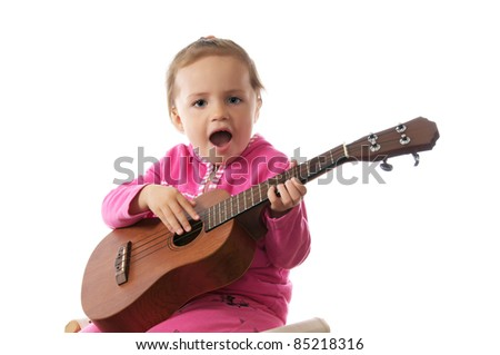 Beautiful little girl playing guitar, isolated on white.