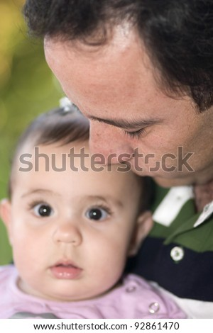 Beautiful Little Girl Playing With Dad Outdoors - stock photo