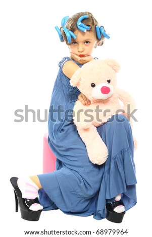 beautiful little girl posing with his teddy bear - stock photo