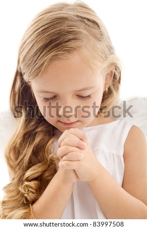 Beautiful little girl praying - closeup, isolated - stock photo