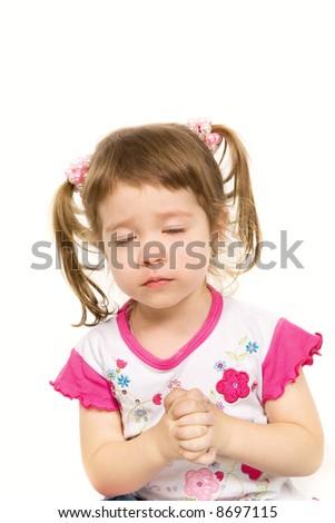 Beautiful little girl praying over white - stock photo