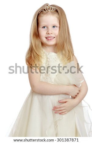 Beautiful little girl princess with flowing blond hair that support color elegant gold diadem. A girl dressed in white dress the air. Close-up-Isolated on white background - stock photo