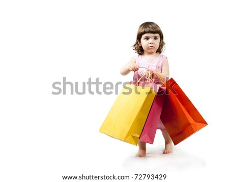 Beautiful little girl shopping colorful paper bags - stock photo
