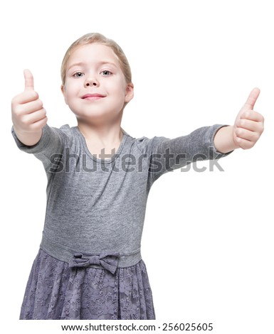 Beautiful little girl showing thumbs up isolated over white background - stock photo