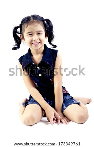 beautiful little girl sitting on the floor  - stock photo