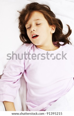 Beautiful little girl sleeping with her mouth open, snoring. Studio shoot - stock photo