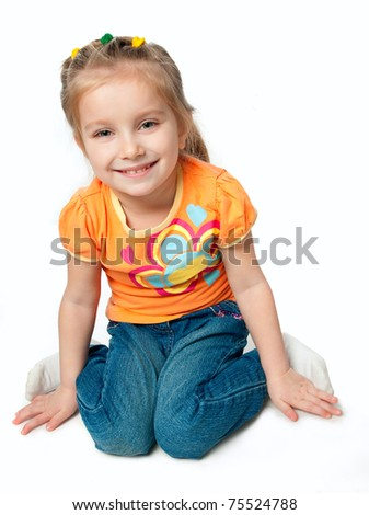 beautiful little girl smiling on a white background - stock photo
