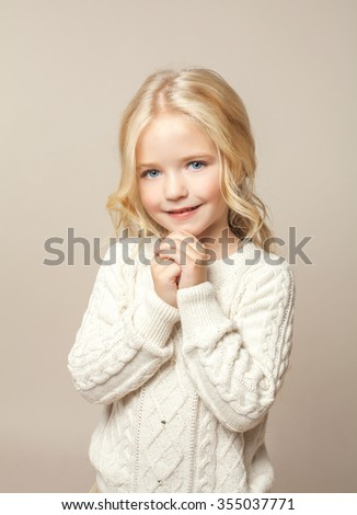 Beautiful little girl smiling. Studio shot - stock photo