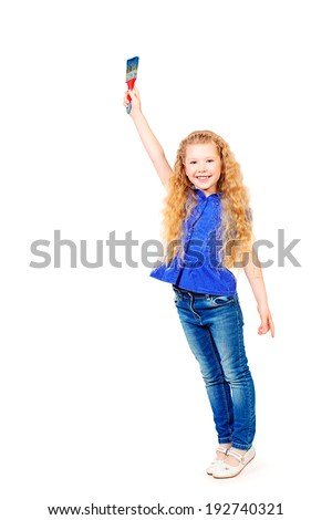 Beautiful little girl standing with a big brush and smiling at camera. Isolated over white. - stock photo