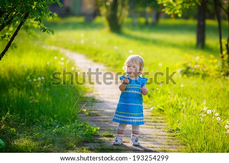beautiful little girl walk in the park