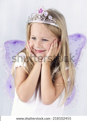 Beautiful little girl wearing diadem and butterfly wings - stock photo