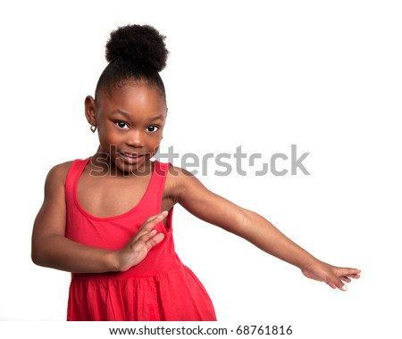Beautiful little girl wearing red dress dances - stock photo
