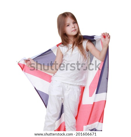 Beautiful little girl with a big flag of of Great Britain isolated on white