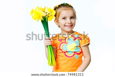 beautiful little girl with a bouquet of daffodils