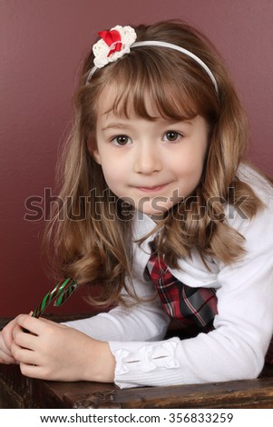 Beautiful little girl with a Christmas candy cane - stock photo
