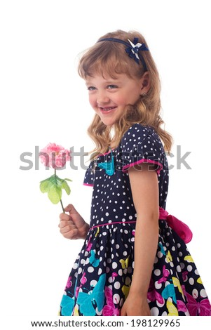 Beautiful little girl with a flower