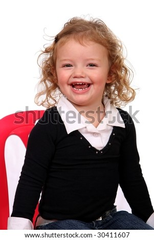 Beautiful little girl with a gorgeous smile and curly hair