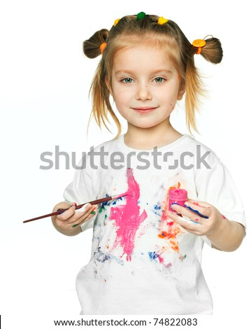 beautiful little girl with a t-shirt in the paint