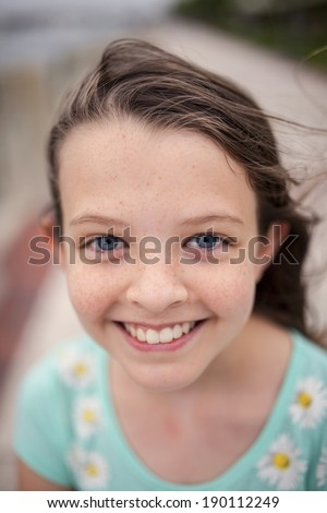 beautiful little girl with blue eyes and freckles, selective focus picture - stock photo