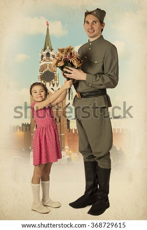 Beautiful little girl with bunch of flowers and Soviet soldier in uniform of World War II in front of Moscow Kremlin.  Monochrome, grunge textures, intentional styled to the 1940s - stock photo