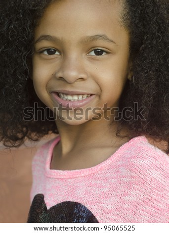 Beautiful little girl with curly hair and pretty - stock photo