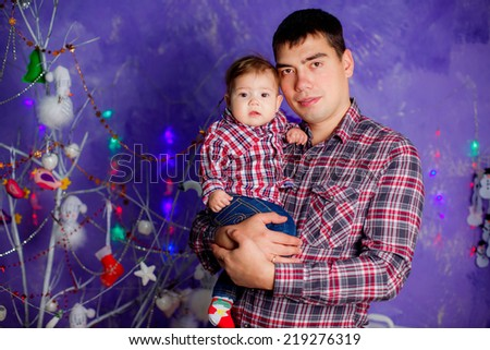 beautiful little girl with her ??father at the hands. new year. Christmas decoration, illumination - stock photo