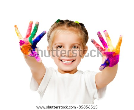 beautiful little girl with her ??hands in the paint - stock photo