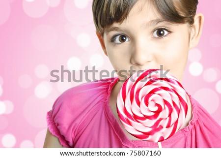 Beautiful little girl with lollipop - stock photo
