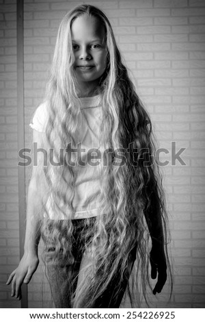 Beautiful little girl with long blonde hair  - stock photo