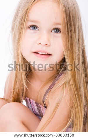 Beautiful little girl with long blonde hair