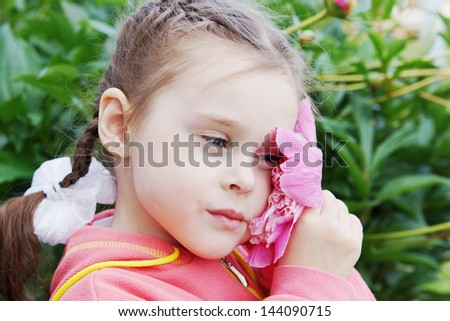 Beautiful Little Girl with Peony Flower - stock photo