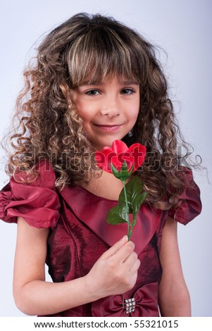 Beautiful little girl with rose - stock photo