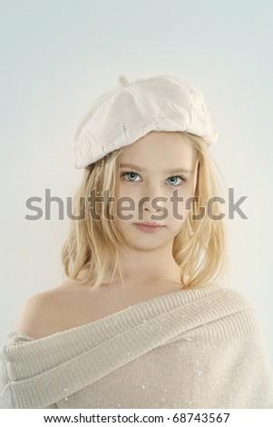 Beautiful little girl with snow. Studio shot - stock photo