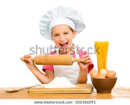 beautiful little girl with spaghetti, flour and eggs on a white background - stock photo