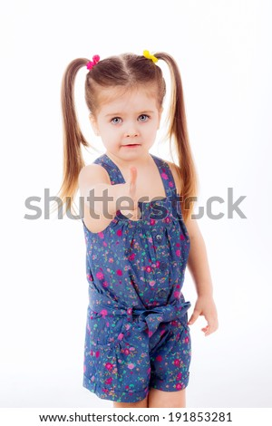 beautiful little girl with two bunches. isolated on white background. emotions, childhood