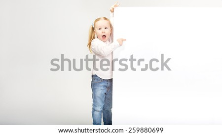 Beautiful little girl with white copy space on a white background - stock photo