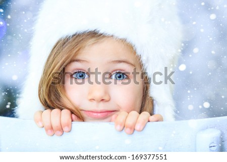 Beautiful little girl with white hat - stock photo