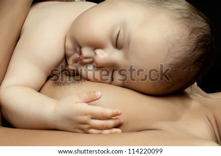 beautiful  little kid, lie on breast and sleep with mother on dark background,  black-and-white - stock photo
