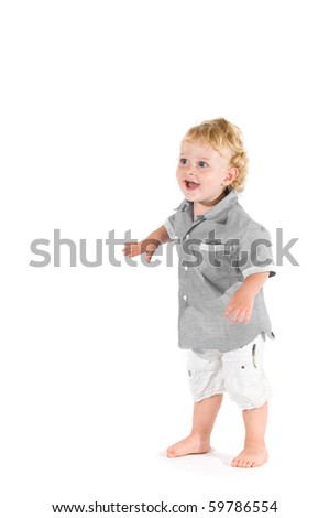 Beautiful little kid standing in equilibrium for his first steps isolated on white background - stock photo