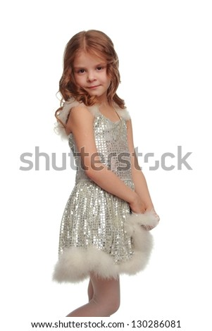 Beautiful little lady in a shiny dress and elegant hairstyle on white background