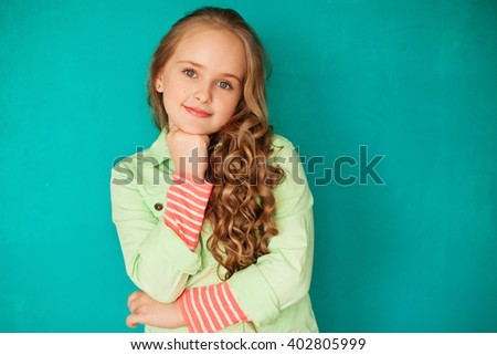 Beautiful little lady in green jacket - stock photo
