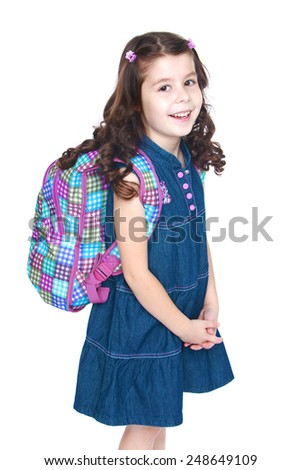 Beautiful little schoolgirl with a knapsack on his shoulders.Isolated on white background, Lotus Children's Center - stock photo
