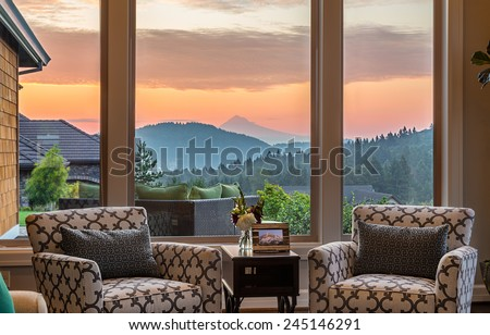 Beautiful Living Room Detail with Sunrise View in New Home - stock photo