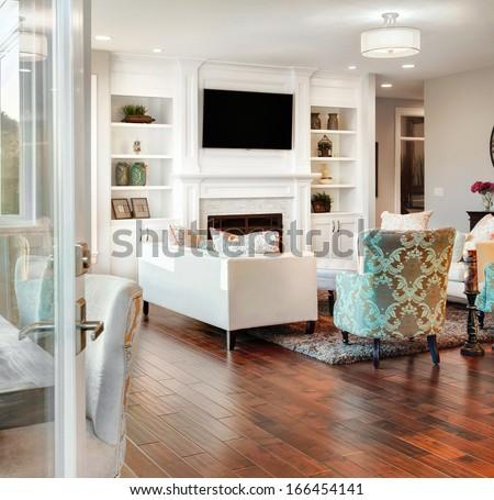 Beautiful Living Room in New Home, as Seen Through Exterior Doorway - stock photo